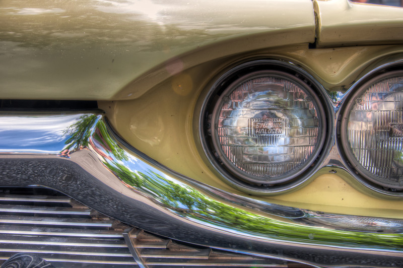 """<h3 style=""""text-align: left;""""><strong>Today's Photo:  Halogen</strong></h3> Back in the spring, I ran across this car show completely by accident.  I was driving through Cartersville looking for churches to shoot and noticed a few cars starting to park near the end of one parking lot.  I stopped to take a look.  This shot was from a 1965 Ford Thunderbird.  I was surprised by the show and, according to others, the show had been canceled, but that was not widely known.  They decided to do it anyway since everyone was showing up."""