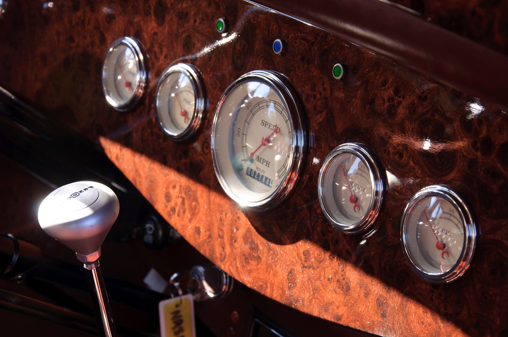 """<h3><strong>Today's Photo: The Roadster Dash</strong></h3> I was looking through my classic car posts and noticed that I have not posted any shots of the interior of these fine cars. I was very surprised to find this out since I have plenty. There is so much detail and attention paid to everything on these cars. From the body to the engine, nothing is overlooked. If it appears as if the car is not finished, all you have to do is ask the owner and they will be happy to tell you what the next step is to getting their car in better shape. One of my favorite places to look on a classic car is the dashboard. Outside of the factory re-make / restored, there are no two alike. Between the dash itself and all the different gauges and dials, there is an endless combination. It is almost as painful waiting for the regular car season to roll back around as it is to wait for football to come back. Now I just need to find something to fill the time between.  Read more at the <a href=""""http://justshootingmemories.com"""">Daily Photography Blog</a> Just Shooting Memories!..."""