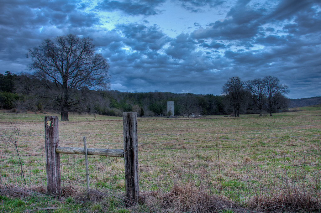 """<h3><strong>Today's Photo: Distant Silo</strong></h3> This was another of those shots that I found driving down the road. It was really just by luck. Most of the time, I have one eyes to the sunset and don't pay attention to what is going on to the east. However, I happened to look the other way and to my surprise, I saw this.  Read more at the <a href=""""http://justshootingmemories.com"""">Daily Photography Blog</a> Just Shooting Memories!..."""