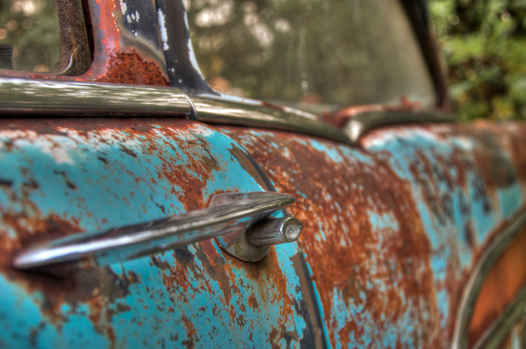 """<h3><strong>Today's Photo: Handled</strong></h3> Today's round brings another shot from Old Car City USA. I ran across this attached to what I think used to be a Chevy Belair. What year, I have no idea. I thought it mad for some good shots. It was <a title=""""Two Tone"""" href=""""http://justshootingmemories.com/2011/09/26/two-tone/"""">two tone</a>, red (rust) and blue. I spent a lot of time with this car and hope to make it back someday. However, I find myself saying that over and over. I know there was still much that I left un-photographed and must make a return trip.  Read more at the <a href=""""http://justshootingmemories.com"""">Daily Photography Blog</a> Just Shooting Memories!..."""