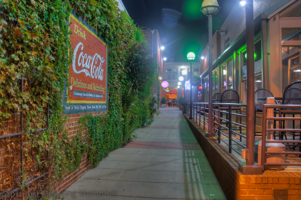 """<h3><strong>Today's Photo: The Alley</strong></h3> I have mentioned in the past how friendly and atmosphere Chattanooga has. There are very few cities that I would walk around and not be worried about getting mugged, Chattanooga is one. Just as an example, this is one of the alley ways near the water front and art district. It was a shame I made it by here after nearly everything was closed. I would have really enjoyed a break about here.  Read more at the <a href=""""http://justshootingmemories.com"""">Daily Photography Blog</a> Just Shooting Memories!..."""