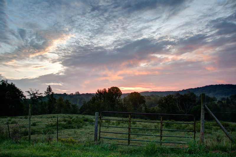 """<h3><strong>Today's Photo: Just Another Gate at Sunrise</strong></h3> It has been awhile since I posted a photo just about a gate. Too bad I have only seen this one in the dark for the last few months. I pass this gate nearly every morning and wonder what the sunrise will be like, but know that I can not stay. The funny thing is, in another couple months, I will be passing it just about at sunrise. At least then I will not have to wonder what the sunrise would be like.  Read more at the <a href=""""http://justshootingmemories.com"""" rel=""""nofollow"""">Daily Photography Blog</a> Just Shooting Memories!..."""