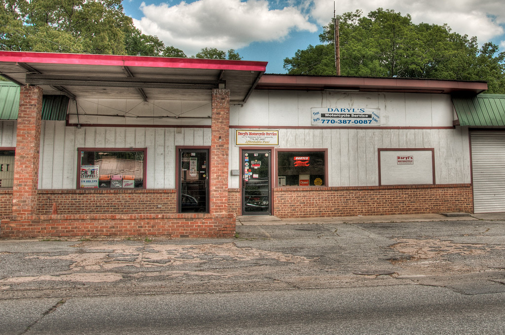 """<h3><strong>Today's Photo: Daryl's Motorcycle Service</strong></h3> I have a kinda normal name, but not the most common spelling of that name. I was driving around the other day when my wife told me to look over at the store next to us. To my surprise, I saw Daryl's Motorcycle Service. I was intrigued enough to grab the camera and get a few shots before moving on down the road. It was unusual to see my name spelled right. I was the one growing up not being able to find my name at any of the cool touristy type gift shop places. I also could not believe that my name was associated with a motorcycle shop. Once I saw that, I half expected my wife to accuse me of a side part time job working on motorcycles, which means I would have to be able to ride. She would not be agreeable to that.  Read more at the <a href=""""http://justshootingmemories.com"""">Daily Photography Blog</a> Just Shooting Memories!..."""