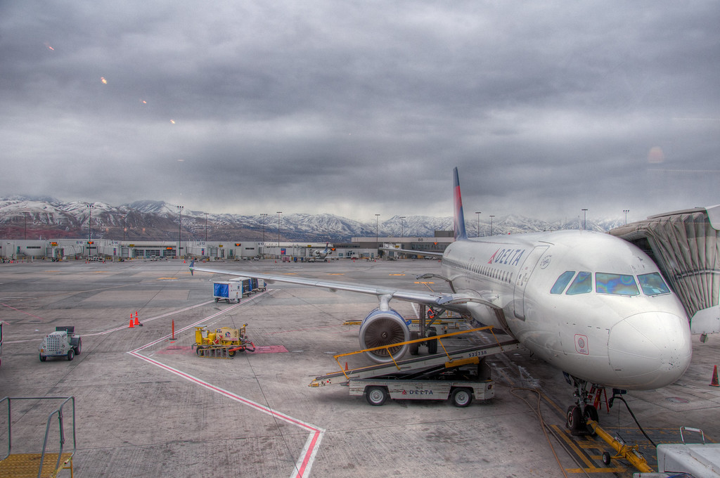 "<h3><strong>Today's Photo:  The Delta View of Salt Lake City</strong></h3> A few weeks ago, I flew to Idaho.  I do not like to make connecting flights whenever I travel.  I am always worried that my first flight will be late and I will miss the next or that my luggage will go missing.  However, in the past few years, I have had to take a couple of connecting flights that have gone through Salt Lake City Utah.  My first experience landing in Salt Lake was really cool.  It was during the summer and it seemed like our flight path took us just over the tops of the surrounding mountains.  Anyway, my last trip went through Salt Lake and had a 2 1/2 hour layover.  I decided to grab a bite to eat in one of the terminals.  The entire back wall was a window looking out on this.  Read more at the <a href=""http://justshootingmemories.com"">Daily Photography Blog</a> Just Shooting Memories!..."
