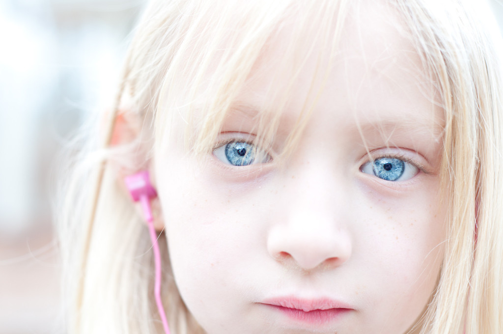 """<h3><strong>Today's Photo: Blue Eyes</strong></h3> I could not hold off posting this one much longer. This is another shot with my new 50mm lens. I have had so much fun with the new lens. My daughter has a habit of putting her headphones on and tuning out the world, or giving me that look when she makes me feel as if she can see all the way through me. There was no way I would have gotten this shot with the kit lens. In fact, I did not have to do much retouching on this photo. It was almost the way I wanted it when it came out of the camera.  Read more at the <a href=""""http://justshootingmemories.com"""">Daily Photography Blog</a> Just Shooting Memories!..."""
