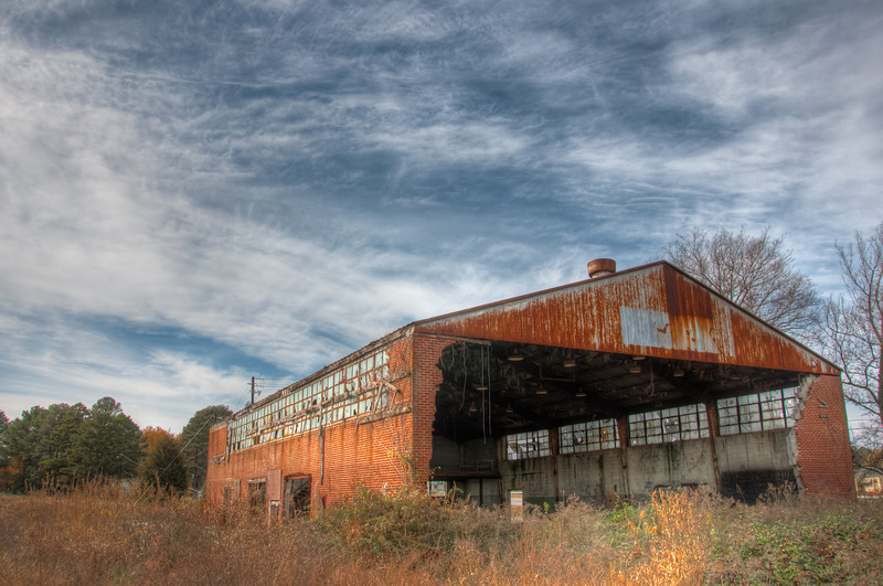 "<h3><strong>Today's Photo:  The Abandoned Warehouse</strong></h3> I love to shoot abandoned buildings.  I have no fear of the dilapidated state of the construction, just of getting caught.  When I was younger, I probably would have thought nothing of it.  However, I am not so young anymore.  This one, on the other hand, has been calling for years.  It sits just beside the road and getting shots of the outside of the building are not so hard.  I think it has become a skate park for most of the local kids.  I haven't seen them there, but there are ramps built all over the inside.  I found a place in Chattanooga that I really want to shoot and have been working on the research to go there legitimately.  Hopefully that will happen soon.  Read more at the <a href=""http://justshootingmemories.com"" rel=""nofollow"">Daily Photography Blog</a> Just Shooting Memories!..."