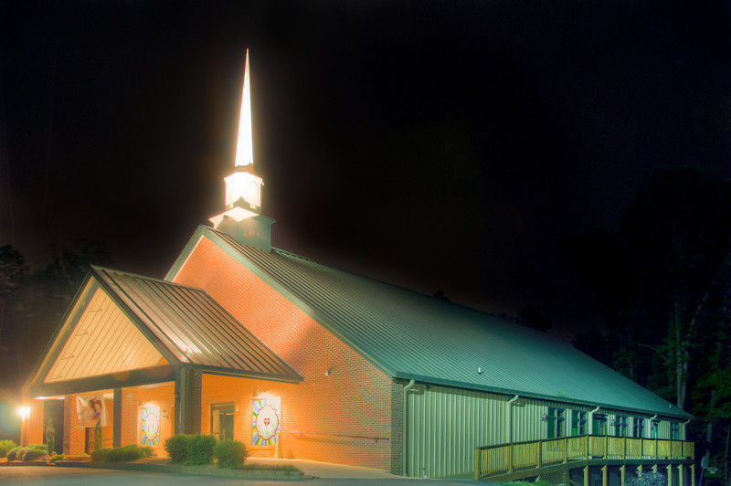 "<h3><strong>Today's Photo:  Hope Lutheran Church</strong></h3> I was in the Ellijay area the other day when I ran across this church.  I saw it from a little way off and decided to try to work my way over to it.  It did not take too long to find the church and it was just in time.  I was only able to get a few shots before it started raining.  This was a very challenging shot trying to get the exposures just right.  I was pleased with the gentle glow from the front and the steeple.  Read more at the <a href=""http://justshootingmemories.com"">Daily Photography Blog</a> Just Shooting Memories!..."