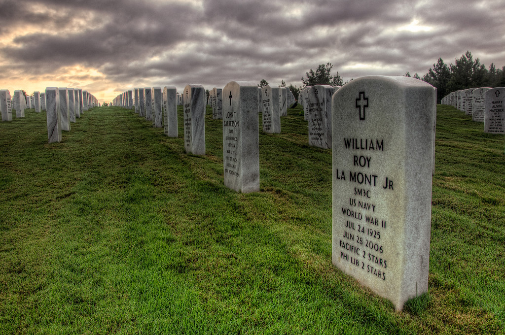 "<h3 style=""text-align: left;""><strong>Today's Photo:  Who's Your Hero</strong></h3> <strong></strong>This past weekend, I decided to try to get some sunrise shots at the Georgia National Cemetery.  I was excited, got up early and hoped for the best lighting possible.  What I got instead was not what I was after.  It rained heavy the night before and as I rolled out, the fog was heavy, but I could still see the stars winking from behind clouds.  As I drove, I ran through patches of fog and clear all the way to the entrance of the cemetery.  Then the fog got so heavy I had to slow down considerably.  There was a great calm across the cemetery and with the fog, it weighed that much greater.  Since this is relatively new cemetery, there are not many graves occupied.  However, I would have to say, there were too many with a date of death much too close to a date of birth.  Walking among the headstones, I had so many feelings.  I could almost feel the heavy burden that was borne by these soldiers, but mixed with the calm of the morning created a feeling of peace that I have rarely felt before.  Whether you agree with what our nation fights for or not, you have to respect these men and women that have taken a stand for the freedoms we enjoy.  Walking among these headstones reminds me that the price for freedom is not free.  Our country was built by the hands of men and women like these and its history books written with the blood that ran in their veins.  God Bless these protectors for they bear a burden the rest of us don't.  Read more at the <a href=""http://justshootingmemories.com"">Daily Photography Blog</a> Just Shooting Memories!..."