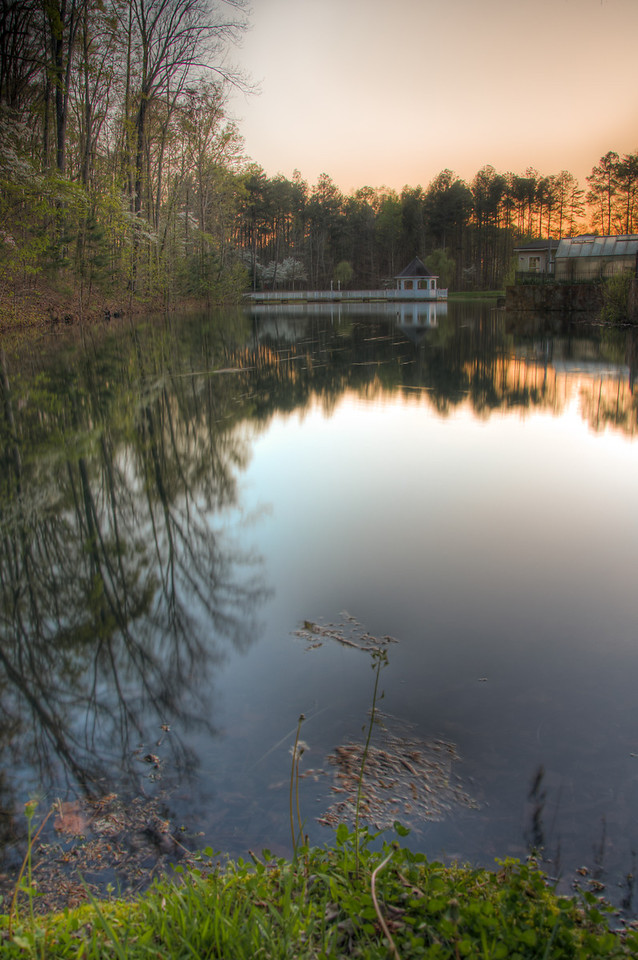 "<h3><strong>Today's Photo:  Lake Reflections</strong></h3> Have you ever seen a photo taken, at the edge of a lake, where you can see the bottom of the lake.  Usually they are very calm and don't look too deep.  I was out by the lake several weeks ago when I noticed that it was pretty calm and decided to try my hand at one of ""those"" photos.  I set up by the shallowest portion of the lake and snapped away.  I did not get the underwater portion as much as I would have liked, but that may have been because it is a little deeper than what I see in most photos.  I wonder if this would turn out with a wider angle lens.  Read more at the <a href=""http://justshootingmemories.com"">Daily Photography Blog</a> Just Shooting Memories!..."