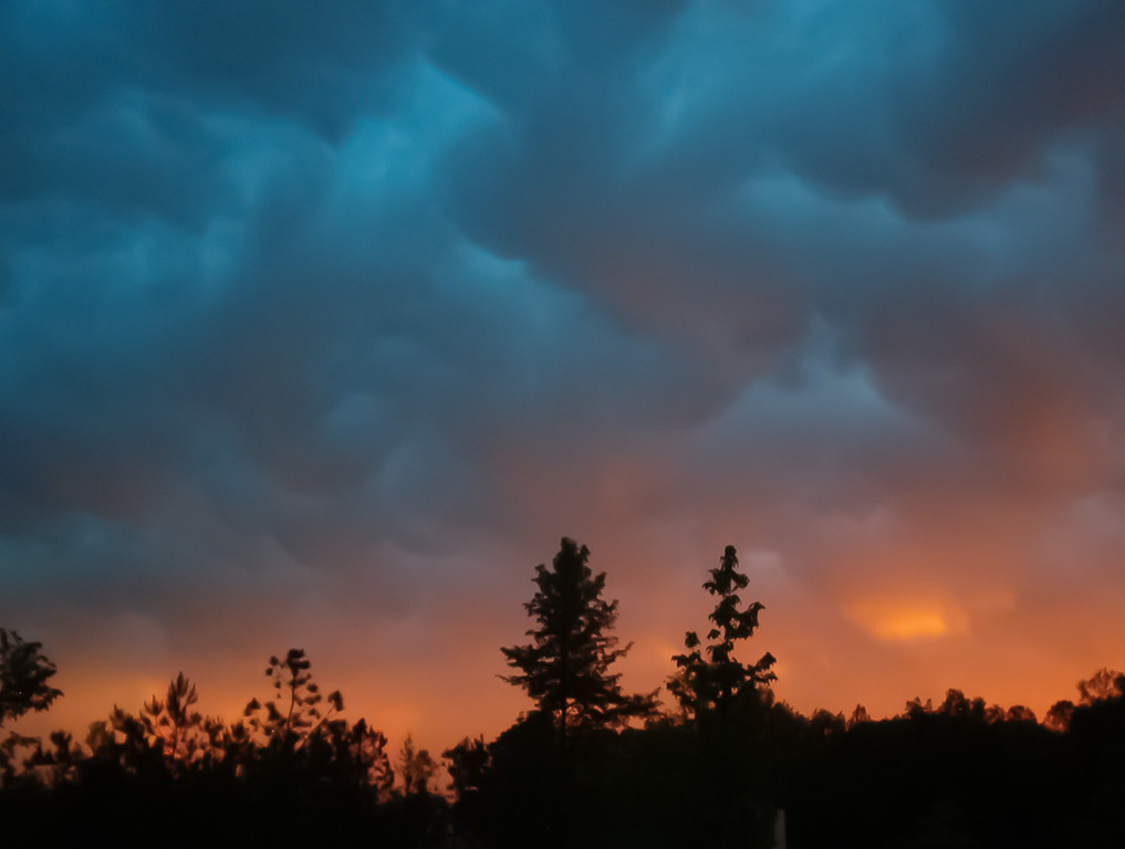 """<h3><strong>Indecision</strong></h3> I had a hard time deciding what photo to post tonight. It was a toss up between a sunset and this. I finally made up my mind when I had to ride the four wheeler out to the gazebo...in the pouring rain. It has rained hard here before, but I don't think it has rained this hard for this long since I have lived here. <a title=""""The Perfect Storm"""" href=""""http://justshootingmemories.smugmug.com/Website/justshootingmemories/19921081_Tt7rDV#!i=1674882698&k=QvTRnG4&lb=1&s=A""""><img title=""""The Perfect Storm"""" src=""""http://justshootingmemories.smugmug.com/photos/i-QvTRnG4/0/XL/i-QvTRnG4-900x900.jpg"""" alt=""""The Perfect Storm"""" /></a> <h3><strong>Today's Photo: The Perfect Storm</strong></h3> I took this shot a long time ago. Somewhere around 8 - 9 years ago with my first digital camera. It was an HP Photosmart 320 which I got from my wife for Christmas. There was a massive storm front, complete with tornados, moving in. There was a perfect wall of clouds and then I would see a triple rainbow. Imagine looking through a tunnel with the underside of the rainbow being the light on the other side (perfect day light), on the outside of the rainbow were these clouds. A few minutes later I caught this brief flare before the sun went down.  Read more at the <a href=""""http://justshootingmemories.com"""">Daily Photography Blog</a> Just Shooting Memories!..."""