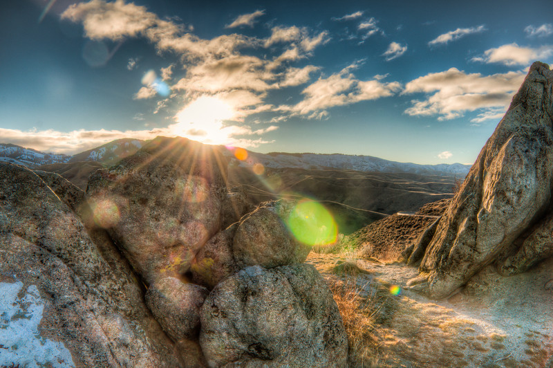 """<h3><strong>Today's Photo: Idaho Sunrise</strong></h3> Several months ago, I spent a few days getting to explore Boise, Idaho. Boise was not exactly what I had imagined. It was flat and the wind was terrible. It was not nearly as cold as I thought it should have been, which was not all that bad. I spent one evening in downtown Boise and a day driving into the mountains. I must confess the drive into the mountains was by far the best. I stopped several times along the way for sunrise photos. This was a set of boulders along the road that intrigued me. I spent a good amount of time watching the sunrise from here.  Read more at the <a href=""""http://justshootingmemories.com"""">Daily Photography Blog</a> Just Shooting Memories!..."""