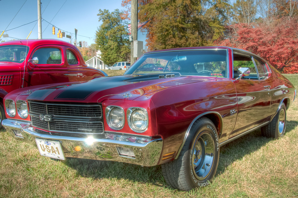 """<h3><strong>Today's Photo: Red and Black</strong></h3> Back near the summer, I began really looking at the local car shows for photographyopportunities. At the first show, I ran across a <a title=""""68 Chevelle SS396"""" href=""""http://justshootingmemories.com/2011/04/08/68-chevelle-ss396/"""">'68 Chevy Chevelle SS</a>. I got a few good shots which brought me back to my childhood and riding in my moms '70 Chevelle SS. Since then, I have made it a point to look for all the Chevelles at each of the car shows. I have found several 1970's, but I still have not found one with the round tail lights. I am afraid I may leave that show a lot lighter in the pockets. But until then, I will settle with Just Shooting Memories.  Read more at the <a href=""""http://justshootingmemories.com"""" rel=""""nofollow"""">Daily Photography Blog</a> Just Shooting Memories!..."""