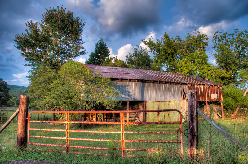 """<h3><strong>Today's Photo: Barn by the Road</strong></h3> Last summer, I found several barns that I really liked. I never made it back by to take photos of them, but I ran across this one the other night. It was tucked along the side of a pretty busy road and you would not have seen it unless you were really trying. I found it only because I was looking for a good spot to park and take sunset photos. Like it was there just for me.  Read more at the <a href=""""http://justshootingmemories.com"""">Daily Photography Blog</a> Just Shooting Memories!..."""