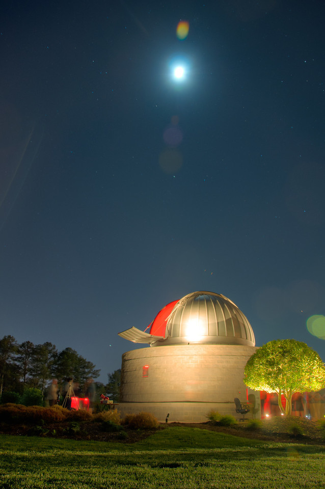 "<h3><strong>Today's Photo:  National Astronomy Day</strong></h3> Saturday April 28 was national astronomy day this year.  I was fortunate enough to take the kids to the Tellus Museum.  We knew there were events all day long including getting to look through the large telescope located at the observatory on the grounds of the museum.  All I can say is, OH WOW!  We waited in the line to get to the observatory and finally made it to the top.  It was our turn and there was no mistaking when the kids first saw Saturn through the eye piece.  What an impressive event and time.  Thank you Tellus for putting on such a great program.  I left the camera in the car so that I could spend some quality time with the family.  We got done just as they closed, but I was able to get back with the camera for a couple shots of the observatory.  I got this one with the moon.  Read more at the <a href=""http://justshootingmemories.com"">Daily Photography Blog</a> Just Shooting Memories!..."