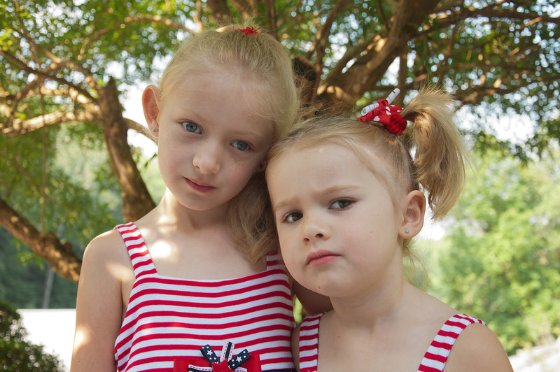 """<h3><strong>Today's Photo:  Double Trouble</strong></h3> What a fitting tribute to 500 posts.  I love to create and capture memories and these two happen to be the inspiration for many of my shots.  There are many times they will be with me when I am out shooting and start taking photos of their own; we made the mistake of getting them Leap Pads.  I think I may have to purchase them real cameras soon.  I keep running across some well composed photos that both have taken.  This shot was after they got dressed up for the Fourth of July tribute service at church.  Read more at the <a href=""""http://justshootingmemories.com"""">Daily Photography Blog</a> Just Shooting Memories!..."""