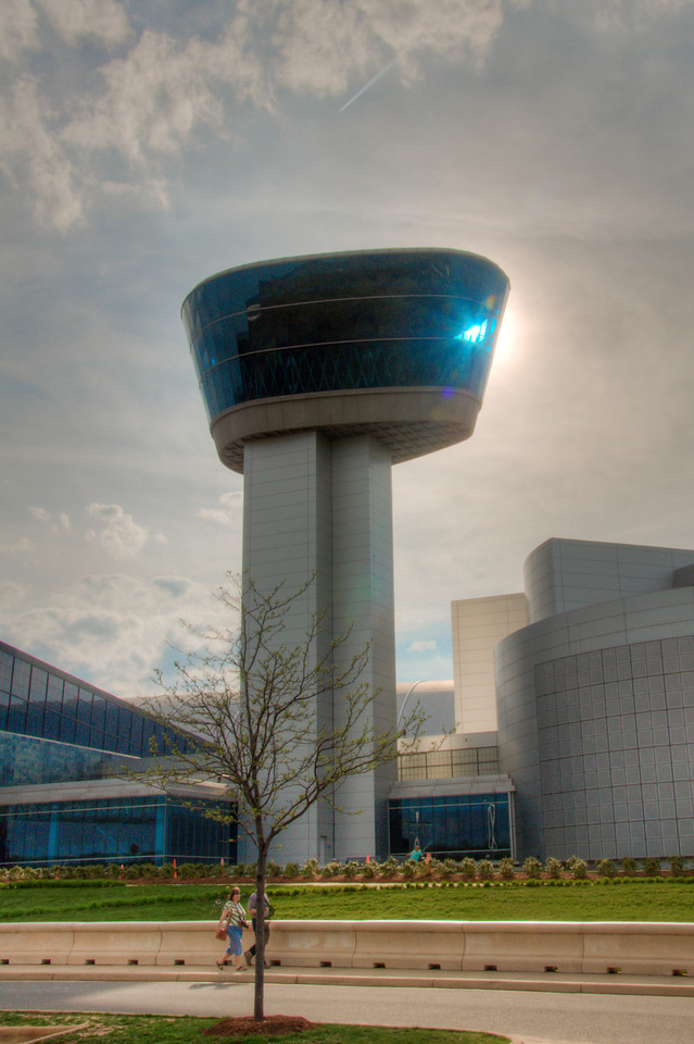 "<h3><strong>Today's Photo:  The Tower Over Dulles</strong></h3> I was able to explore most of the Air and Space Museums Udvar-Hazy center.  It was a whirlwind and I did not get to spend the amount of time I really wanted.  One of the places I really wanted to go was the Donald D. Engen tower.  It looks over the Udvar-Hazy center and the end of Dulles International airport.  In fact, that is the way most of these planes have gotten to the museum.  They fly them into Dulles and taxi to the back of the building.  I would have loved to get up to the top for a view of the airport, but tours to the tower stop before the center closes.  Unfortunately, I did not make it before the last tours.  Read more at the <a href=""http://justshootingmemories.com"">Daily Photography Blog</a> Just Shooting Memories!..."