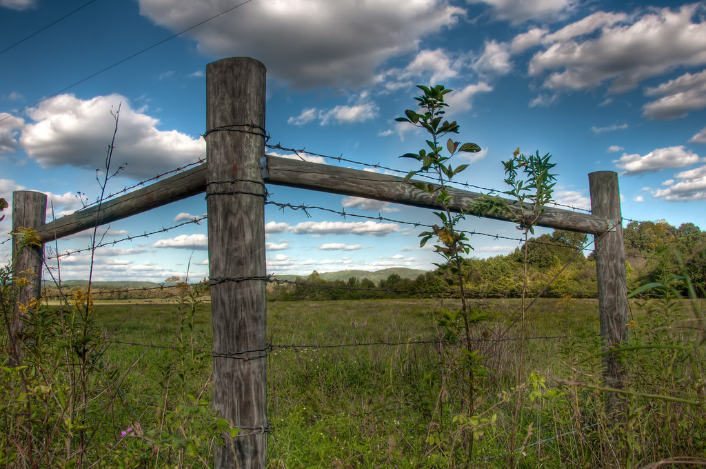 "<h3><strong>Today's Photo:  The Corner Post</strong></h3> There are so many cool things to see while driving around the country side.  It is nearly impossible to make it anywhere in any decent time when there are good clouds in the sky.  Between the gates, barns and just plain old good scenery, I tend to get a good shot in every now and then.  It is amazing what can be found within a few feet of the road.  Read more at the <a href=""http://justshootingmemories.com"" rel=""nofollow"">Daily Photography Blog</a> Just Shooting Memories!..."