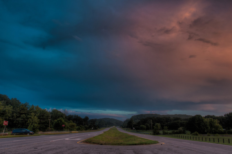 """<h3><strong>Today's Photo: The Great Divide</strong></h3> The other day, I got a few minutes to get out and make a dedicated sunset photo trip. I try hard to, but usually they don't turn out as good as I want, or the sunset isn't all that great. Fortunately, this one was. Not only was the western horizon really good, the entire sky faded from a dark blue/purple to an orange/pink color. I parked on the other side of the road from where I was shooting and snapped this one when I was returning to the car. I would not recommend this to anyone. Cars, when they made it by, were flying.  Read more at the <a href=""""http://justshootingmemories.com"""">Daily Photography Blog</a> Just Shooting Memories!..."""
