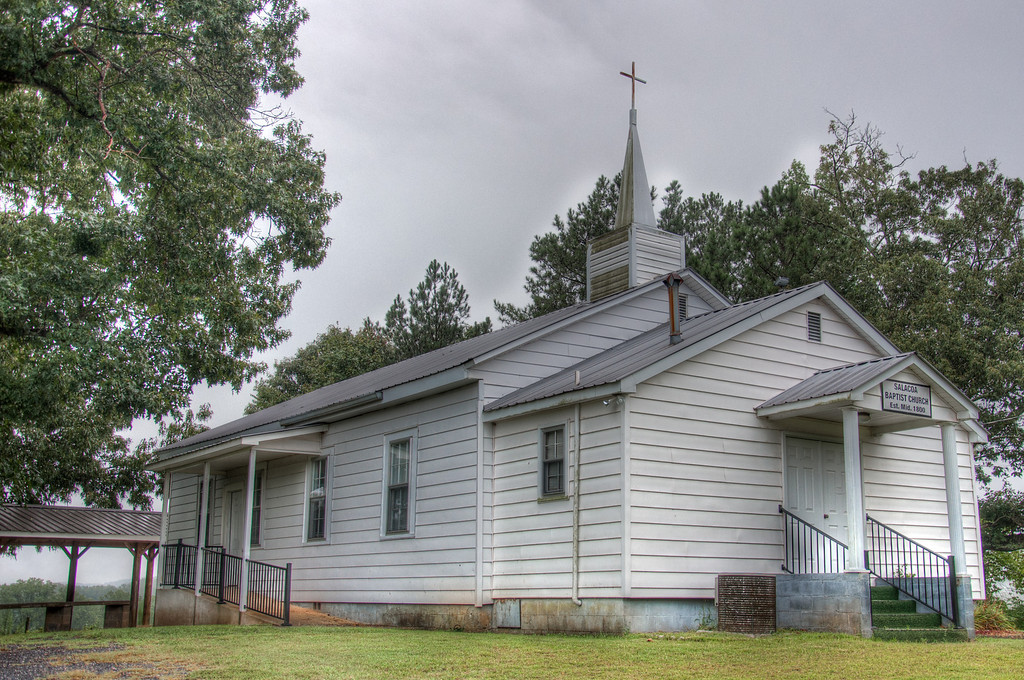 "<h3 style=""text-align: left;""><strong>Today's Photo:  Salacoa Baptist Church</strong></h3> <strong></strong>One of my favorite things about driving around in the country is you never know what you will find.  I was driving through a small area called Salacoa, north of Atlanta, and ran across this little church.  It is a prime example of a typical Appalachian church.  You know something is old when even the church members can't tell how long ago the church was established. (Click on the photo for a large version and look at the sign over the door.)  Read more at the <a href=""http://justshootingmemories.com"">Daily Photography Blog</a> Just Shooting Memories!..."