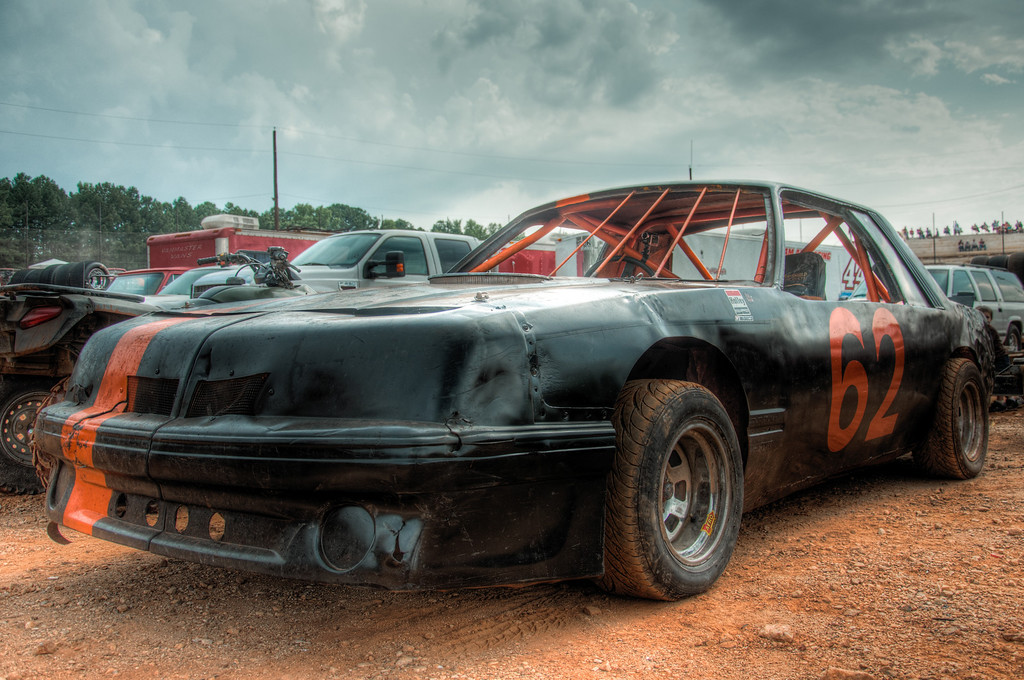 "<h3><strong>Today's Photo:  Before the Dirt at Dixie Speedway</strong></h3> My soon to be nephew races at a local dirt track called <a title=""Dixie Speedway"" href=""http://www.dixiespeedway.com"" target=""_blank"">Dixie Speedway</a>.  He invited me a couple of months ago to take photos of him racing.  Well, I was finally able to go this past weekend.  I have been to several Nascar races, including Daytona International Speedway, but nothing had prepared me for this.  Since I was there to take photos for him, naturally I got a Pit Pass and spent the majority of the time on the infield.  It rained just before the race and made for some interesting early laps to get the track back into racing condition.  I took tons of photos and will definitely be back.  This one is before the mud bath.  Read more at the <a href=""http://justshootingmemories.com"">Daily Photography Blog</a> Just Shooting Memories!..."