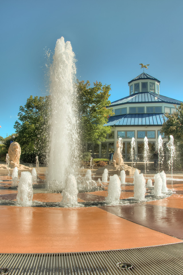 "<h3><strong>Today's Photo:  The Fountain at Coolidge Park</strong></h3> I must say it is lots of fun to shoot fountains.  This one was especially fun because the fountain was set up to change the height of the water jets.  I took lots of shots of this during the World Wide Photowalk.  My only complaint was that there were no good clouds that day.  Other than that, it was not too hot, to cold or wet.  I know that while I was getting these shots, there were several other photographers there also.  I know some people are into candid shots, but I don't know if anyone got one of me.  Someday I may ask them.  Read more at the <a href=""http://justshootingmemories.com"">Daily Photography Blog</a> Just Shooting Memories!..."