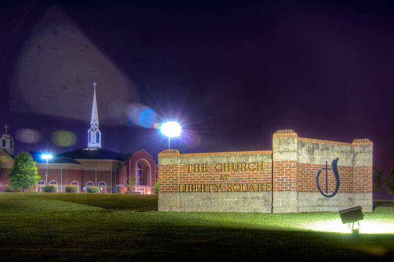 """<h3><strong>Today's Photo: Beacon at Night (Church at Liberty Square)</strong></h3> Finally, back to my Sunday churches series. I stopped by the Church at Liberty Square last night to take photos of the flags out front for the Fourth of July. I really liked the flags, but they were not lit like I wanted them to be. However, I took the time to take a few other photos of the church that I was wanting to take for a while. The only problem was that I had not been near it after dark lately. Even though the flags were not lit, I really liked the way the church was lit like a beacon in the night.  Read more at the <a href=""""http://justshootingmemories.com"""">Daily Photography Blog</a> Just Shooting Memories!..."""