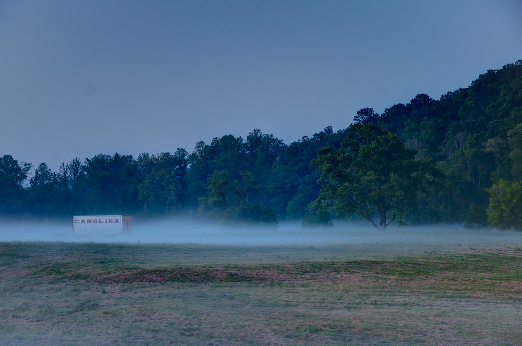 "<h3><strong>Today's Photo:  Carolina in the Fog</strong></h3> I pass this usually during the day.  There are normally horses in the pasture which would make a great shot also.  However, I never seem to be able to get the time during the day.  I took the kids to First Friday in Canton again and happened to make it by here just at dusk.  We had a few good storms during the day and the fog was starting to rise.  A great example of the blue hour.  Read more at the <a href=""http://justshootingmemories.com"">Daily Photography Blog</a> Just Shooting Memories!..."
