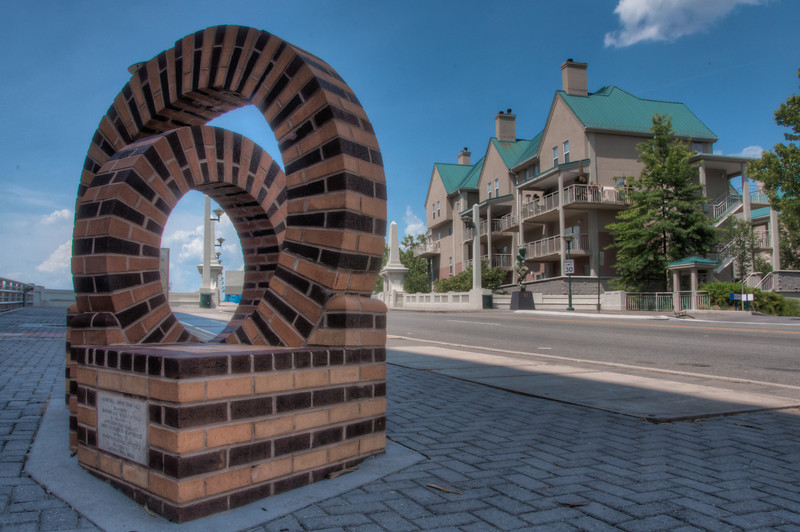 """<h3><strong>Today's Photo: Water Wheel</strong></h3> Chattanooga is my second home. I don't get to spend as much time there as I want, so I have to work hard to plan shots before I go. This is one that I have tried numerous time to get. I always seem to get tons of traffic when I get in the area and set up. This is the """"Water Wheel"""" sculpture that sits by the edge of the Market Street bridge. I timed this one just right and fit three exposures in between cars driving by.  Read more at the <a href=""""http://justshootingmemories.com"""">Daily Photography Blog</a> Just Shooting Memories!..."""