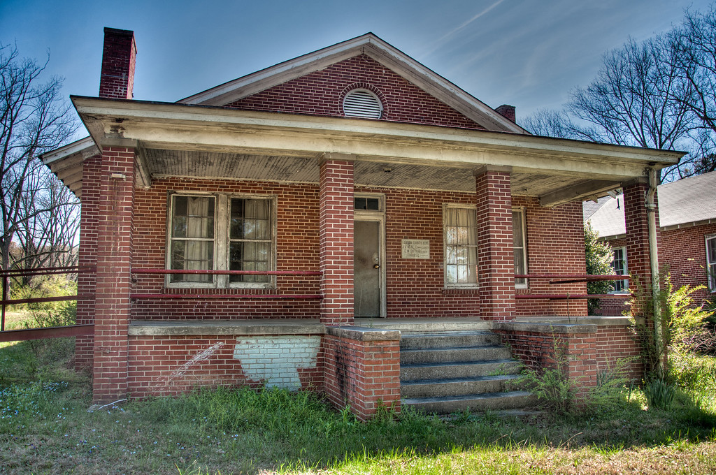 "<h3><strong>Today's Photo:  Bartow County Home</strong></h3> This is another of those buildings which I have seen hundreds of times and thought of stopping to take photos.  Well, over the summer, I did exactly that.  I knew it was a rundown establishment of some sort, but not what.  The front is graced by a nice long wheelchair ramp and the building has three chimneys.  There is a sign on the front of the building which says ""Bartow County Home / A V Neal Commissioner / E W Smith Builder / 1930""  I did some research and have been unable to locate the purpose of this building.  It almost looks like it could have been a nursing home or something similar.  It is located on Highway 411 just north of White, Georgia.  If anyone know the history, please pass it on?  Read more at the <a href=""http://justshootingmemories.com"" rel=""nofollow"">Daily Photography Blog</a> Just Shooting Memories!..."