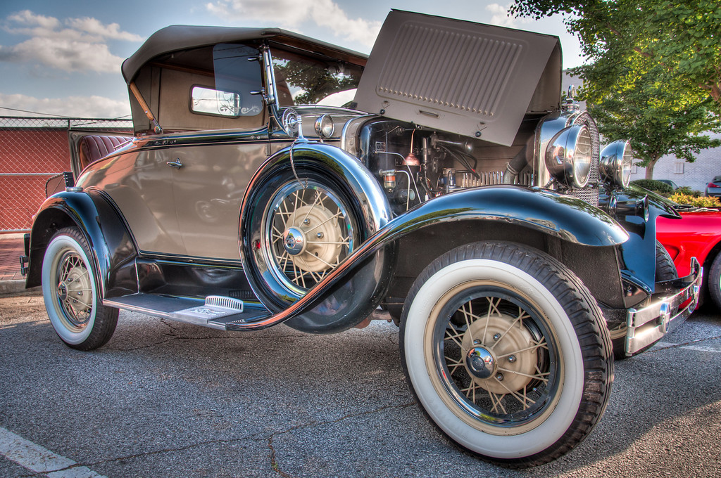 """<h3><strong>Today's Photo: Ford Model A</strong></h3> I usually try to separate photos from the same event / place by several days at least. However, there were so many cool cars, I could not resist this one. I was so busy taking photos that I never stopped to ask what year this was. The best I can tell, it is a Ford Model A. There was a time when everything was so much simpler. Sometimes, I wish it still could be simple. You don't need a fancy computer or someone who has trained for years to fix this. After spending several hours working on my car, I could use one of those people or one of these Model As.  Read more at the <a href=""""http://justshootingmemories.com"""">Daily Photography Blog</a> Just Shooting Memories!..."""