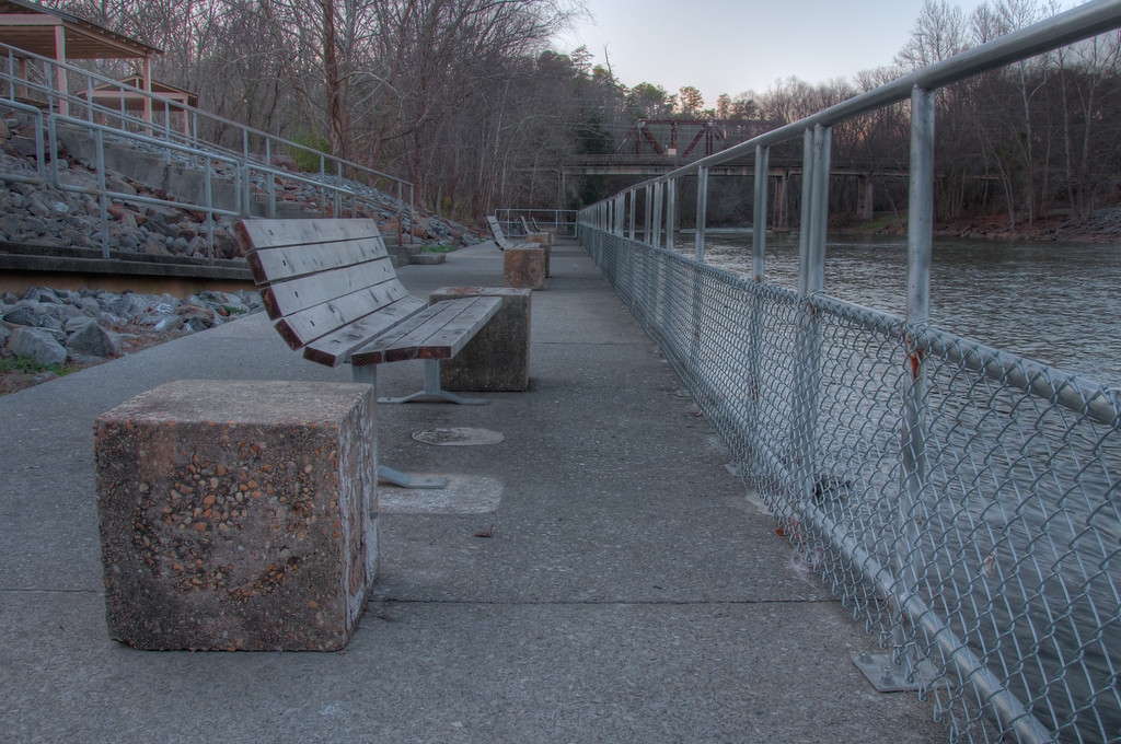 """<h3><strong>Today's Photo: Empty Benches</strong></h3> Well, its the end of another college football season, the Pros are winding down and fantasy football has ended. It is the season of empty football benches and cold locker rooms. I did not find these benches near any stadium, but they had the same off season expectant feel. Like there was something great about to happen and no one was there yet. Only a couple games left for the Pros. Good by football for another year.  Read more at the <a href=""""http://justshootingmemories.com"""">Daily Photography Blog</a> Just Shooting Memories!..."""