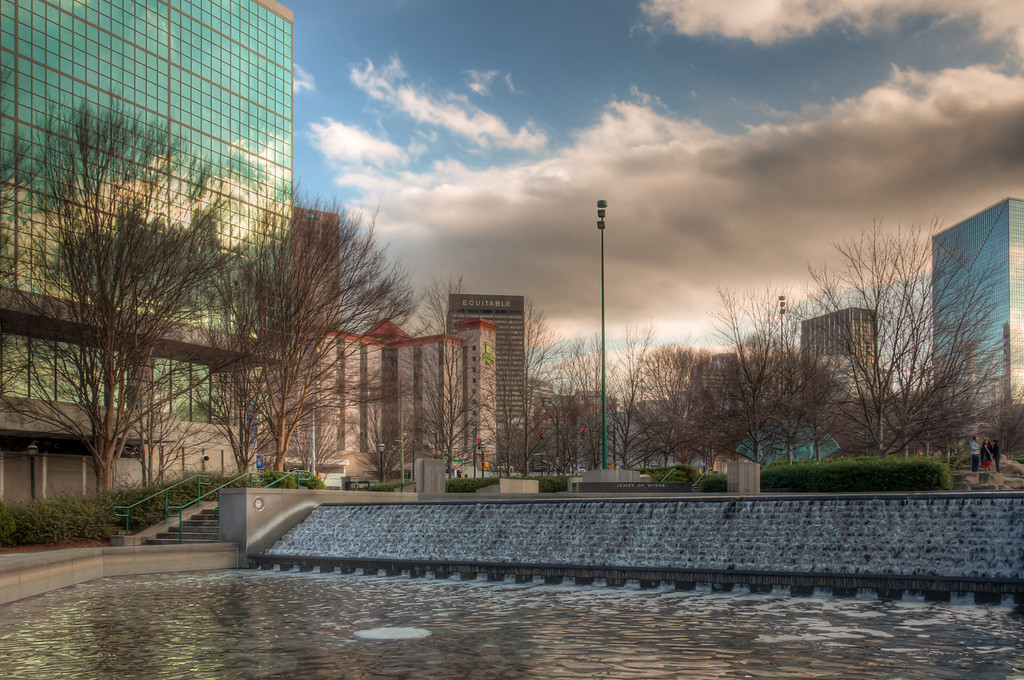 """<h3><strong>Today's Photo: An Olympic Waterfall</strong></h3> Situated in downtown Atlanta is theCentennialOlympic Park. This park attracts tons of visitors each year and I have had plans to visit for awhile, but not the time. However, I was able to make it for a couple of hours about a week ago. I was intrigued by all the waterfalls and fountains that traverse the park. I had been to the park once before, but not explored much of it. I must commend Atlanta for setting aside such a large area in downtown. If you follow the waterfalls through the park, about halfway through, you will find this one. It was one of the less crowded of the numerous waterfalls.  Read more at the <a href=""""http://justshootingmemories.com"""">Daily Photography Blog</a> Just Shooting Memories!..."""