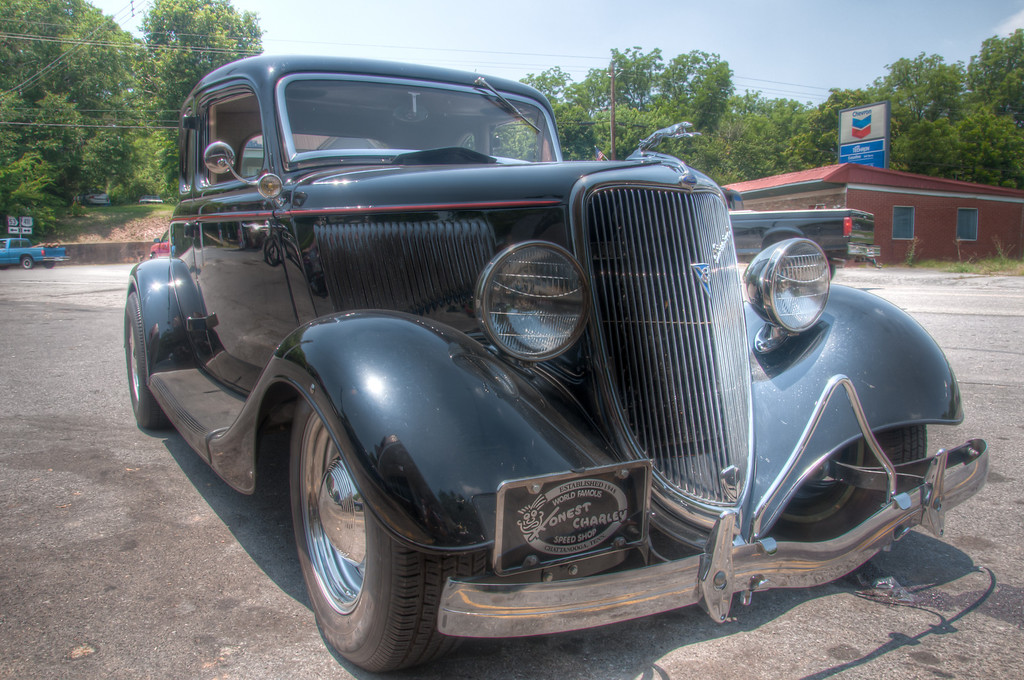 "<h3><strong>Today's Photo:  Honest Charley</strong></h3> Surely by now you know I have a thing for classic cars.  I love to go to car shows and see them all lined up.  It's like going to Disneyworld.  I can get my senses overloaded in a very short time and I don't have to go all over the place.  However, sometimes I find the rare gem riding around all by it's lonesome or with only a couple of friends, like the <a title=""Flamin' Chevy"" href=""http://justshootingmemories.com/2011/10/26/flamin-chevy/"">Flamin' Chevy</a>.  This was one of those I found outside a local dining establishment.  In fact, this used to be a Tasty Freeze, but I doubt there are many out there that remember it as such.  Points to anyone who can name what it is now.  Read more at the <a href=""http://justshootingmemories.com"" rel=""nofollow"">Daily Photography Blog</a> Just Shooting Memories!..."