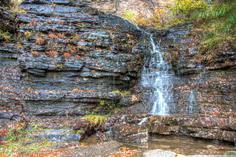 """<h3 style=""""text-align: left;""""><strong>Today's Photo:  The Roadside Falls</strong></h3> On the way home from Fall Creek Falls, we were driving down Highway 111 just outside Dunlap Tennessee.  There was a small pullout next to the road with a couple picnic benches.  It was not the picnic benches that caught my attention.  It was the double waterfall behind the benches.  Although my photos of the waterfall were pretty good (my opinion), it was the photos my wife took of my daughter watching me that impressed me.  Mine is above, hers is below.  Not bad for an iPhone photo."""