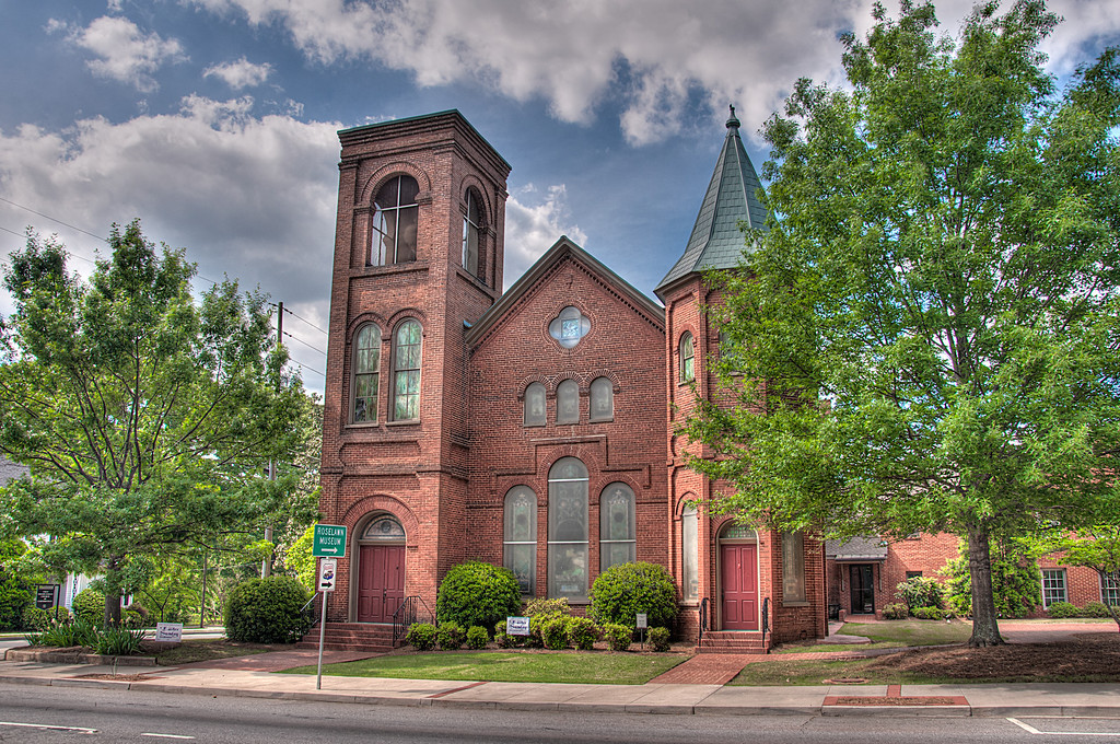 """<h3><strong>Today's Photo: First Presbyterian Church of Cartersville</strong></h3> Today brings another round in my churches series. This is in the heart of downtown Cartersville Georgia. I have been past it many times and always admired the medieval look. That was always my favorite time in history to study. I hated that there were no real medieval castles or good centuries old buildings and fortifications to be able to look at in the United States. Maybe one day I will have the chance to visit England or one of the other European countries. Anyone want to sponsor me for a month photo tour? One can dream, right.  Read more at the <a href=""""http://justshootingmemories.com"""">Daily Photography Blog</a> Just Shooting Memories!..."""