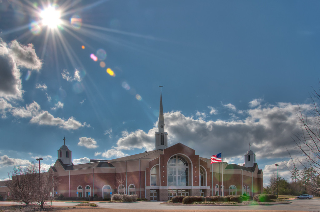 """<h3><strong>Today's Photo: The Church at Liberty Square</strong></h3> A while back, my wife suggested that I begin a series on Sundays of churches. I have slowly, but surely, begun gathering photos of churches that I have run across. However, the one I wanted to capture most was where we attend, The Church at Liberty Square. I go everywhere with my camera, so this was not a hard task, but things just did not come together as I wanted. That all changed last Sunday with good clouds and the sun in the right position. I noticed this as we left church, and it was just my luck (or something like that ;-) ), that kept the clouds in the sky and made for a good shot. Don't forget: Church starts at 10:45 sharp.  Read more at the <a href=""""http://justshootingmemories.com"""">Daily Photography Blog</a> Just Shooting Memories!..."""