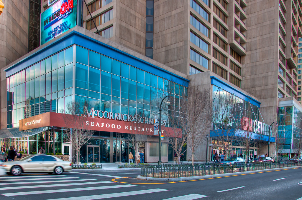 """<h3><strong>Today's Photo: McCormick and Schmicks</strong></h3> There are tons of cool looking buildings in downtown Atlanta. I was able to spend a little while capturing them a couple weeks ago. This is the McCormick and Schmicks which is the corner of the CNN center building. If you like seafood, it is actually pretty good.  Read more at the <a href=""""http://justshootingmemories.com"""">Daily Photography Blog</a> Just Shooting Memories!..."""