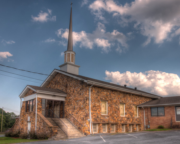 """<h3 style=""""text-align: left;""""><strong>Today's Photo:  Woffords Crossroads Baptist Church</strong></h3> <strong></strong>Some of the best places I find to photograph are purely by accident / exploration.  The exploration mode was what I was in the day I ran across this church.  It was not in any place one would find it purely by accident.  You have to either look for it or be exploring.  I found this church maintaining a commanding view over, none other than, Woffords Crossroads.  If you miss the stop sign, your next step would be a trip through this parking lot.  Read more at the <a href=""""http://justshootingmemories.com"""">Daily Photography Blog</a> Just Shooting Memories!..."""