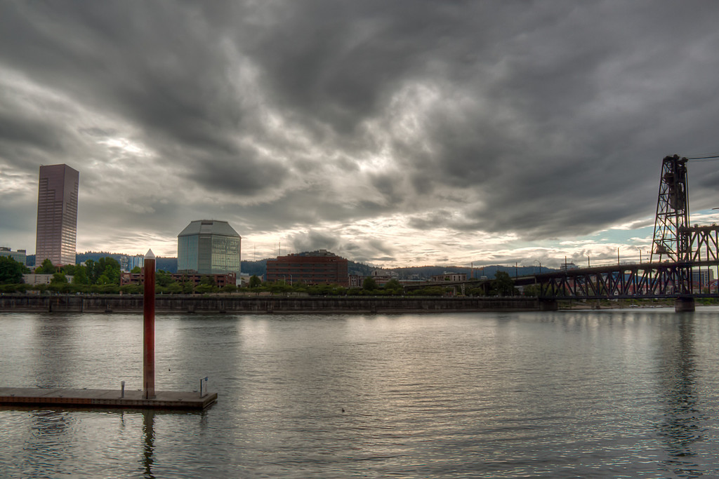 "<h3><strong>Today's Photo:  Portland Over the Esplanade</strong></h3> A couple years ago, I got to go to Portland, Oregon.  It was my first trip to the Pacific Northwest.  The hotel I was staying in was right by the water and the Esplanade.  I took a couple of evenings and walked most of the Esplanade.  Unfortunately, I only took the camera for one of those trips.  One day I shall make it back and take many more photos.  This shot is from the East bank of the Williamette River looking back toward downtown Oregon.  Read more at the <a href=""http://justshootingmemories.com"">Daily Photography Blog</a> Just Shooting Memories!..."