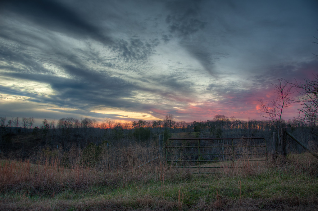 "<h3><strong>Today's Photo:  Gentle Sunset</strong></h3> I wont even say I was going to write something long today, because I have been too busy to even think about it.  However, here is the shot for the day. Another of those painted on sunsets and a gate.  Read more at the <a href=""http://justshootingmemories.com"">Daily Photography Blog</a> Just Shooting Memories!..."