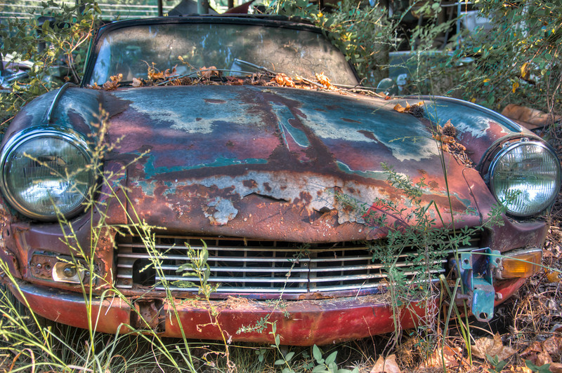 """<h3><strong>Today's Photo: Bug Eyed</strong></h3> Last fall I spent a nice morning running around the six miles of trails through an antique junk yard. It is billed as the largest junk yard of classic cars and I would have to believe it. There were hundreds, if not thousands, of cars lined up and stacked on one another through out the compound. Old Car City is not usually open on Saturdays, but I was able to sneak in when the owner had it open for a photography group out of Chattanooga. What was really funny was that was essentially the same group that I did the Worldwide Photo Walk with in Chattanooga. This pile of junk, I mean classic car, was hiding back a little way and out of site. I don't think many people get by to see this one.  Read more at the <a href=""""http://justshootingmemories.com"""">Daily Photography Blog</a> Just Shooting Memories!..."""