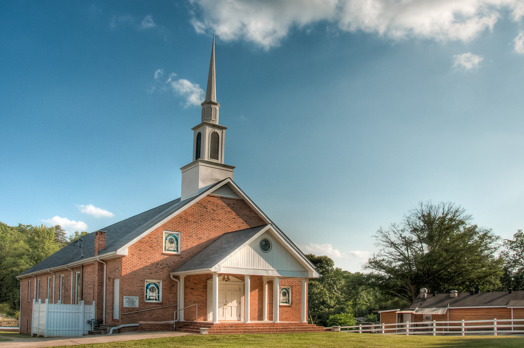 "<h3><strong>Today's Photo:  Chalcedonia Baptist Church</strong></h3> Today's photo brings another round in my Sunday <a title=""Churches Gallery"" href=""http://justshootingmemories.smugmug.com/Architecture/Churches/22807898_zKJWR8#!i=1700376730"" target=""_blank"">Churches</a> theme.  This one is located just north of Canton Georgia on Old Highway 5.  I had seen some really good clouds all day long, but alas, the quality of them went down toward the evening and I only got these in the photo.  Right across the street, the church members were setting up for a yard sale.  I got some really odd looks when I pulled  into the parking lot and started taking photos.  I guess they were looking for what I was bringing to the yard sale.  I hope they were not expecting me to leave the camera.  Read more at the <a href=""http://justshootingmemories.com"">Daily Photography Blog</a> Just Shooting Memories!..."