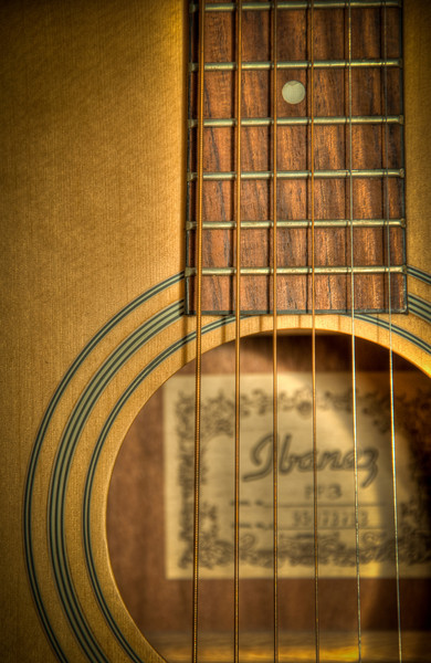 """<h3><strong>Today's Photo: The Old Guitar</strong></h3> Is it true that things get better with age? I hear that all the time. I am not so sure though. I think it is all just a ploy because some people can't handle getting old. I got this guitar for my 18th birthday. It has remained unchanged for many years, but the tune is still as true as when I got it. I used to get it out and play the couple of tune that I know, but the time I set aside for that has been tasked else where. It is always nice when friends that actually know how to play stop by and give it a workout. Maybe it is not that things get better or worse with age. Maybe it is that they are just different, but still the same.  Read more at the <a href=""""http://justshootingmemories.com"""">Daily Photography Blog</a> Just Shooting Memories!..."""