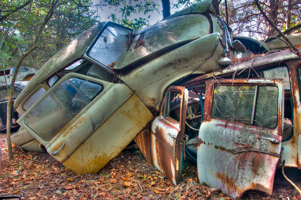 "<h3><strong>Today's Photo:  Wrecked</strong></h3> This shot is from the back lot of Old Car City.  Now, Old Car City is a junk yard.  Usually you see cars lined up all nice and neat waiting for parts to be salvaged or the car to be scrapped.  I don't ever remember seeing a wreck in a junk yard until this one.  This must be what happens at the junkyard after everyone leaves.  Time for the demolition derby.  Read more at the <a href=""http://justshootingmemories.com"">Daily Photography Blog</a> Just Shooting Memories!..."