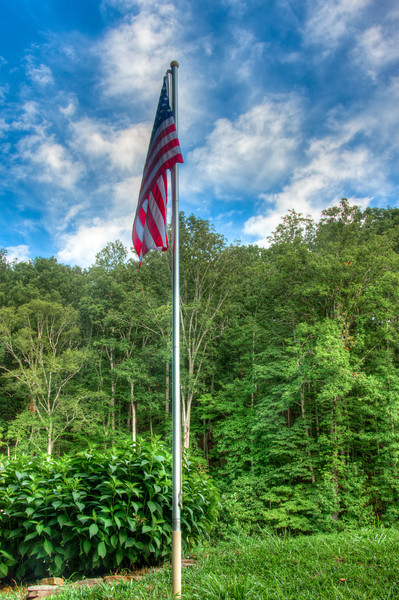"""<h3><strong>Today's Photo: The Summer Flag</strong></h3> So, I am flying through for a few minutes today and I am way late with this post. I hope to maketonight'son time, but this will have to serve for today's just a few hours late.  There was just a small amount of wind for this shot. I wanted to get a good three exposure shot of this, but the wind was not constant enough. So, this is just a single exposure.  Read more at the <a href=""""http://justshootingmemories.com"""" rel=""""nofollow"""">Daily Photography Blog</a> Just Shooting Memories!..."""