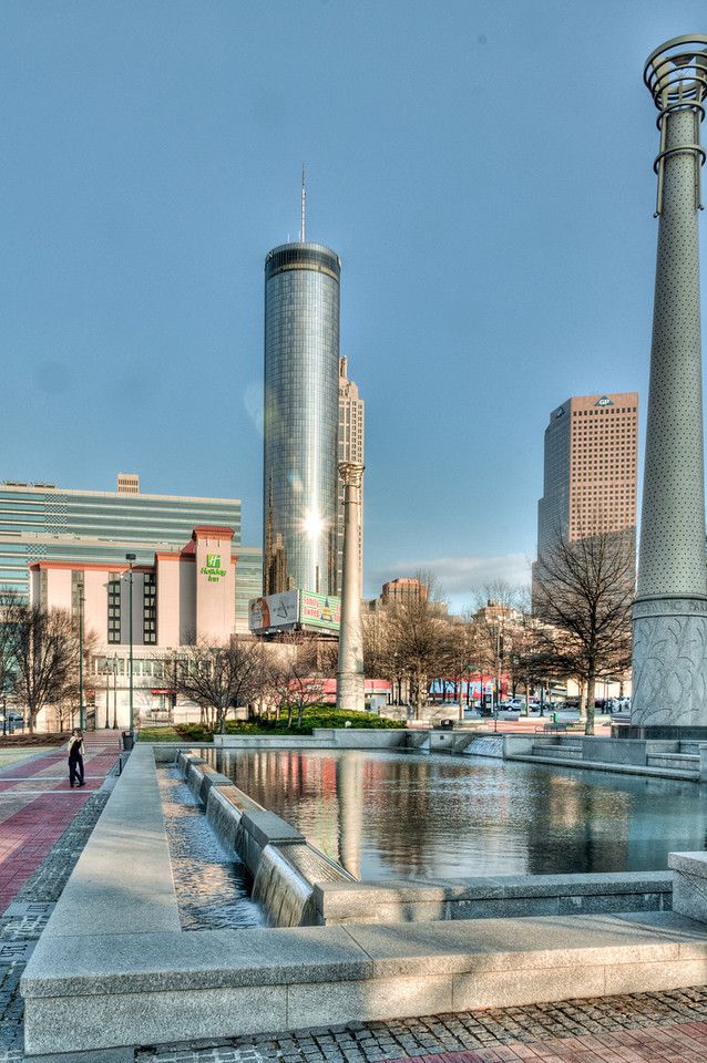 "<h3><strong>Today's Photo:  Olympic Park Reflecting Pool</strong></h3> Centennial Olympic Park in the heart of downtown Atlanta is a great place for photography.  There are tons of water falls, pools and fountains located throughout the park.  However, bring your walking shoes because you will not realize how far you go before starting back.  If you make it here during the winter, you can even catch a few laps around the ice rink.  This is a shot of the pool just across the road from the Olympic Rings Fountain.  I had been to the park many times and somehow I did not remember this was here.  I guess I just got caught up in everything else going on.  Read more at the <a href=""http://justshootingmemories.com"">Daily Photography Blog</a> Just Shooting Memories!..."