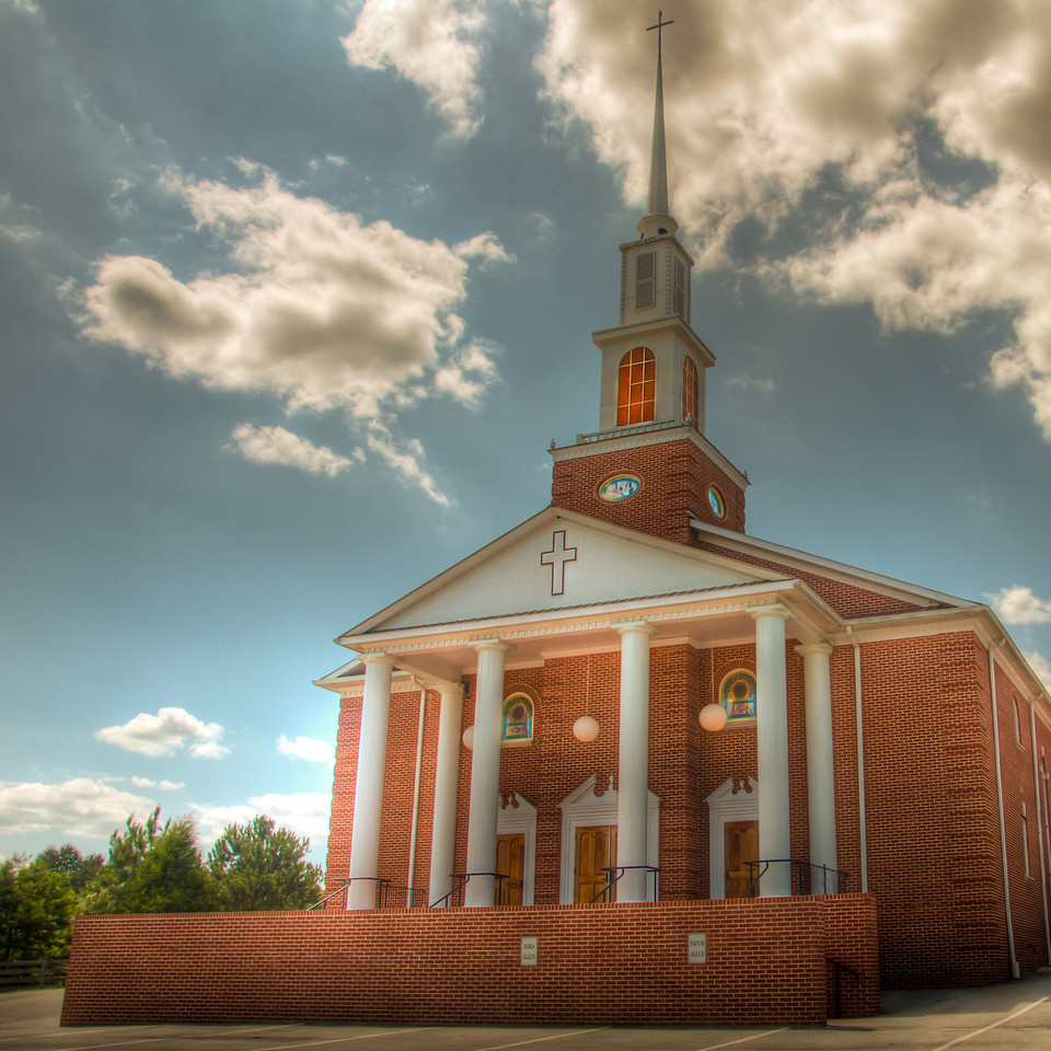 """<h3><strong>Today's Photo: Concord Baptist Church</strong></h3> Another week has gone by and I get to post another church. 52 for a year is not too bad. I am sure I should be able to find that many in the south. Even that many cool looking photogenic churches should not be that hard to find. I found this one just down the road from <a title=""""Sonoraville Baptist"""" href=""""http://justshootingmemories.com/2012/02/19/sonoraville-baptist/"""">Sonoraville Baptist Church</a>. I have been fortunate enough to have some good clouds for these photos lately.  Read more at the <a href=""""http://justshootingmemories.com"""">Daily Photography Blog</a> Just Shooting Memories!..."""