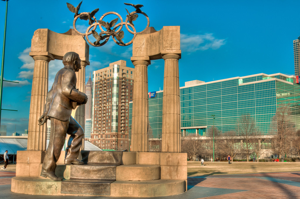 """<h3><strong>Today's Photo: Olympic Park</strong></h3> I had great plans to post a photo from my weekends jaunts. However, that is not going to happen. This shot is another from Centennial Olympic Park in downtown Atlanta. I have no idea what the name of this statue is. I thought it was pretty cool. I wish there had been better light reflecting from the building across the park. My goal was to get the sunset in the reflection, but there just was not a good reflection.  Read more at the <a href=""""http://justshootingmemories.com"""">Daily Photography Blog</a> Just Shooting Memories!..."""