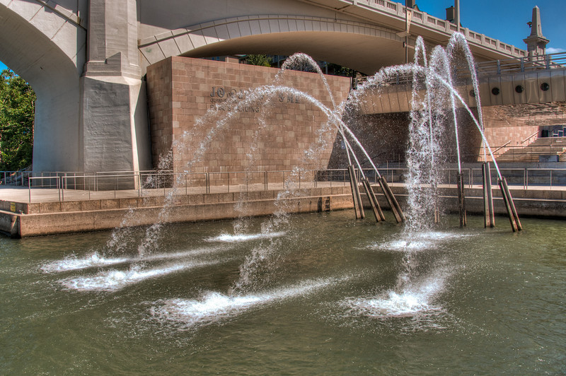 """<h3><strong>Today's Photo: Flying Water</strong></h3> Since the first time I saw these water cannons last fall, I have been fascinated with them. Almost every time I have been back, I have attempted to get a shot of these. Some turned out the way I wanted and others did not. If you look at the underside of the bridge on the right, you can see reflections of waves. Those are from a pool that is right under the bridge. I think I may try to get a shot of that the next time I am in the area. The middle of the pool has a circle with what looks like a spider. Maybe that will be coming soon.  Read more at the <a href=""""http://justshootingmemories.com"""">Daily Photography Blog</a> Just Shooting Memories!..."""