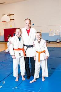 Chloe Wilson (14), Judo Coach Mark Dantzler, Alexandra Wilson (12).